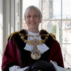 Mayor Christine Cross wearing official robes and chain
