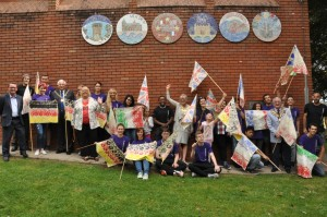 All 6 Mosaics on the wall of the Leisure Centre at St Nicholas Park with the team of people who took part.