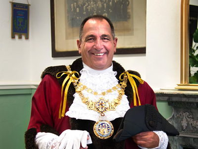 Councillor Neale Murphy wearing the Mayoral regalia