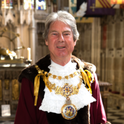 Mayor Stephen Cross wearing official robes and chain