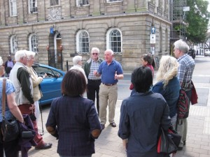 A volunteer showing a group of visitors around